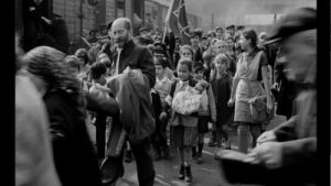 "Korczak leading ""his"" children to the trains."